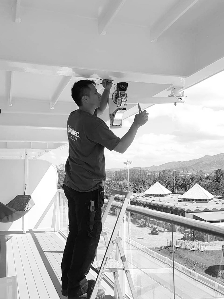 unitec marine worker installing on balcony
